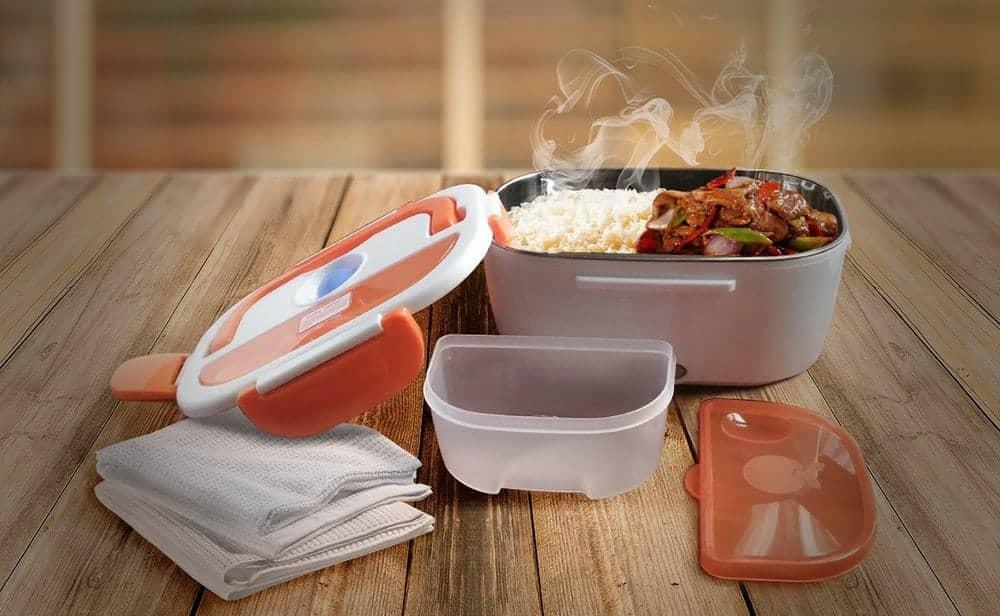 Fiambrera eléctrica con la comida a la temperatura perfecta para comer